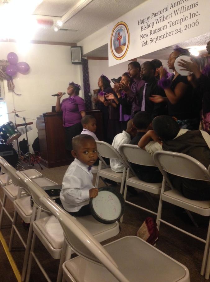 Playing the tambourine during Anniversary service